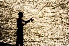 Młoda fisher sylwetka fotografia stock