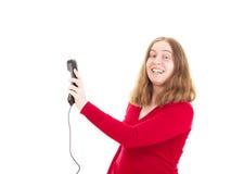 Młoda kobieta dzwoni somebody Fotografia Stock