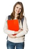 Młoda kobieta jest ubranym plecaka i trzyma botebooks Zdjęcie Royalty Free