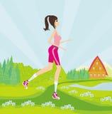 Młoda kobieta jogging przy parkiem Obraz Stock