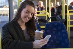 Młoda kobieta na autobusie Fotografia Royalty Free
