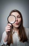 Kobieta z magnifier Obrazy Royalty Free