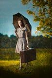 Młoda kobieta pod deszczem Zdjęcia Stock