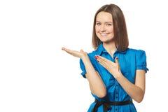 Młoda kobieta punkty produkt Zdjęcie Stock