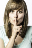 Młoda kobieta trzyma palec jej usta Obraz Royalty Free