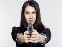 Młoda kobieta trzyma pistolet Obraz Stock