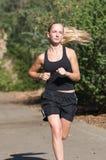 Młoda kobieta w czarny jogs. Zdjęcia Stock