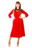Młoda kobieta w jaskrawej czerwonej wieczór sukni Zdjęcie Royalty Free