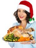 Młoda Kobieta w Santa mienia Kapeluszowej pieczeni Turcja i warzywach Zdjęcie Royalty Free