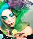 Młoda kobieta z cukierkami Obrazy Royalty Free