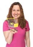 Młoda kobieta z mini wózek na zakupy Fotografia Stock