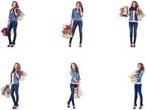 M?oda kobieta z torba na zakupy odizolowywaj?cymi na bielu zdjęcie stock