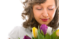 Młoda kobieta z tulipanami Zdjęcia Stock