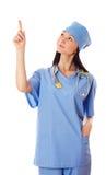 Młodej kobiety doktorski wskazuje palec upwards Zdjęcie Royalty Free