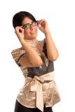 Młodej kobiety mienia eyeglasses Zdjęcia Stock