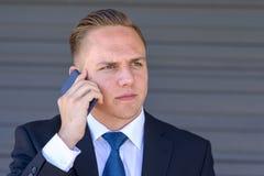 Młody biznesmen bierze telefonu komórkowego wezwanie Obraz Stock
