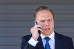 Młody biznesmen bierze telefonu komórkowego wezwanie Obrazy Stock