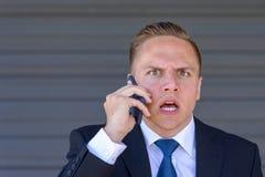 Młody biznesmen bierze telefonu komórkowego wezwanie Fotografia Stock