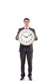 Młody biznesmen trzyma zegar Fotografia Royalty Free