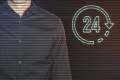 Młody biznesmen z 24 godzinami ikon Zdjęcia Royalty Free