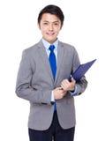 Młody biznesmena chwyt z schowkiem Fotografia Royalty Free