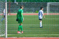 Młody gracza futbolu dopasowanie zdjęcia royalty free