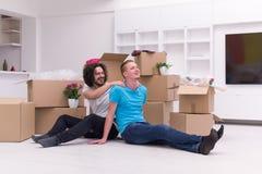 Młody homoseksualny pary chodzenie w nowym domu Zdjęcie Royalty Free