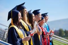 Młodych absolwentów uczni grupa Fotografia Royalty Free