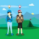Młodzi ludzie obozuje GPS Obrazy Stock