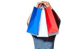 Młodzi monger mienia torba na zakupy na bielu Obrazy Royalty Free
