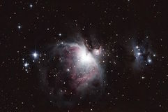 M42 - Orion Nebula e o homem running Imagem de Stock Royalty Free