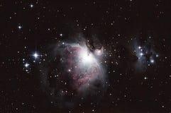 M42 - Orion Nebula och den rinnande mannen Royaltyfri Bild