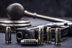 Młoteczka i pistoletu dobra Obrazy Stock