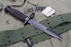 M16 rifle bayonet. On uniform bacground royalty free stock photos