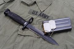 M16 rifle bayonet. On uniform bacground royalty free stock photography