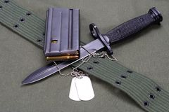 M16 rifle bayonet. On uniform bacground stock image