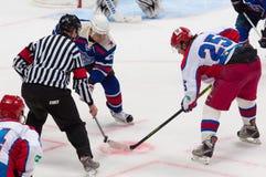 M. Salimov (25, B) and V. Zelepukin(25, R) on faceoff. RUSSIA, MOSCOW - APRIL 27, 2015: M. Salimov (25, B) and V. Zelepukin(25, R) on faceoff on hockey game CSKA Stock Photography