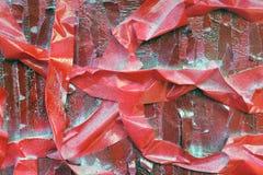 M?scaras brilhantes do vermelho escarlate das listras na superf?cie textured foto de stock