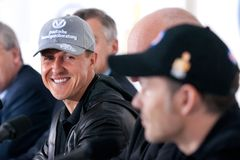 M Schumacher. Michael Schumacher looking at former F-1 rival, Jacques Villeneuve, at CAA press conference, to promote electronic safety equipment on cars Royalty Free Stock Image