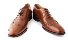 Męscy moda buty na bielu Obrazy Royalty Free