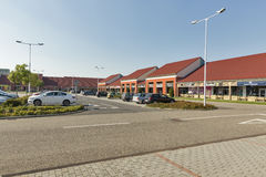 M3 Shopping Mall in Polgar, Hungary. Cars parked in front of M3 Shopping Mall just by the M3 highway leading to Debrecen and Nyiregyhaza royalty free stock photography