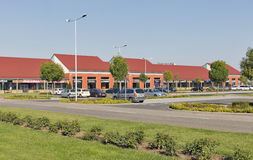 M3 Shopping Mall in Polgar, Hungary. Cars parked in front of M3 Shopping Mall just by the M3 highway leading to Debrecen and Nyiregyhaza stock photos
