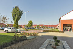 M3 Shopping Mall in Polgar, Hungary. Unrecognized people visit M3 Shopping Mall just by the M3 highway leading to Debrecen and Nyiregyhaza royalty free stock image