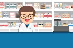 Męska farmaceuta przy kontuarem w aptece Obraz Royalty Free