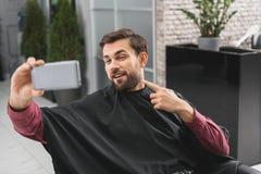 Męska klient blaga jego fryzura Obraz Royalty Free
