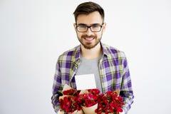 Męska ogrodniczka z kwiatami Obraz Royalty Free