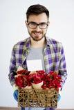 Męska ogrodniczka z kwiatami Fotografia Stock