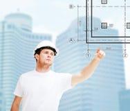 Męski architekt wskazuje przy projektem Fotografia Stock
