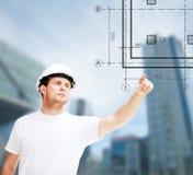 Męski architekt wskazuje przy projektem Zdjęcie Royalty Free