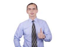 Męski biznesmen pokazuje kciukowi up gest przeciw. Obrazy Royalty Free